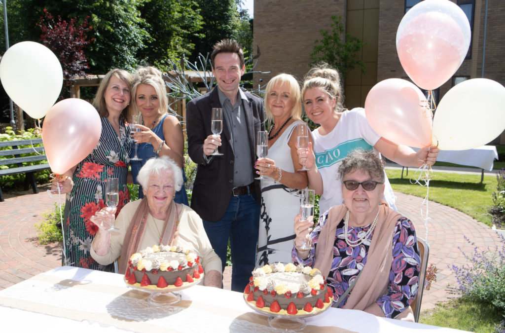 [L-R] A phpto of Angela Luckett, Emma Rodger, Pauline Pike, Manchester City Councillor John Leech, Debbie Baker, Ashley Alldred and Angela Postma at Belong Morris Feinmann's second birthday