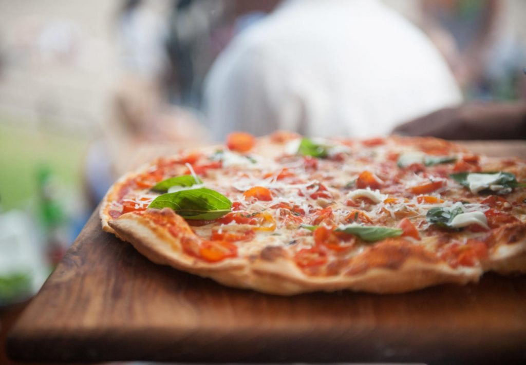 Pizza on tray, selective focus