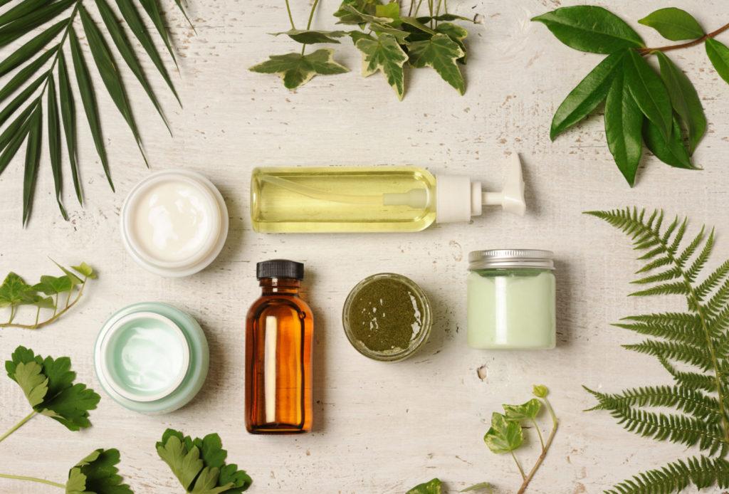arrangement of natural herbal cosmetics on wooden background