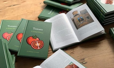 Copies of book Tomato: A Global History on a table