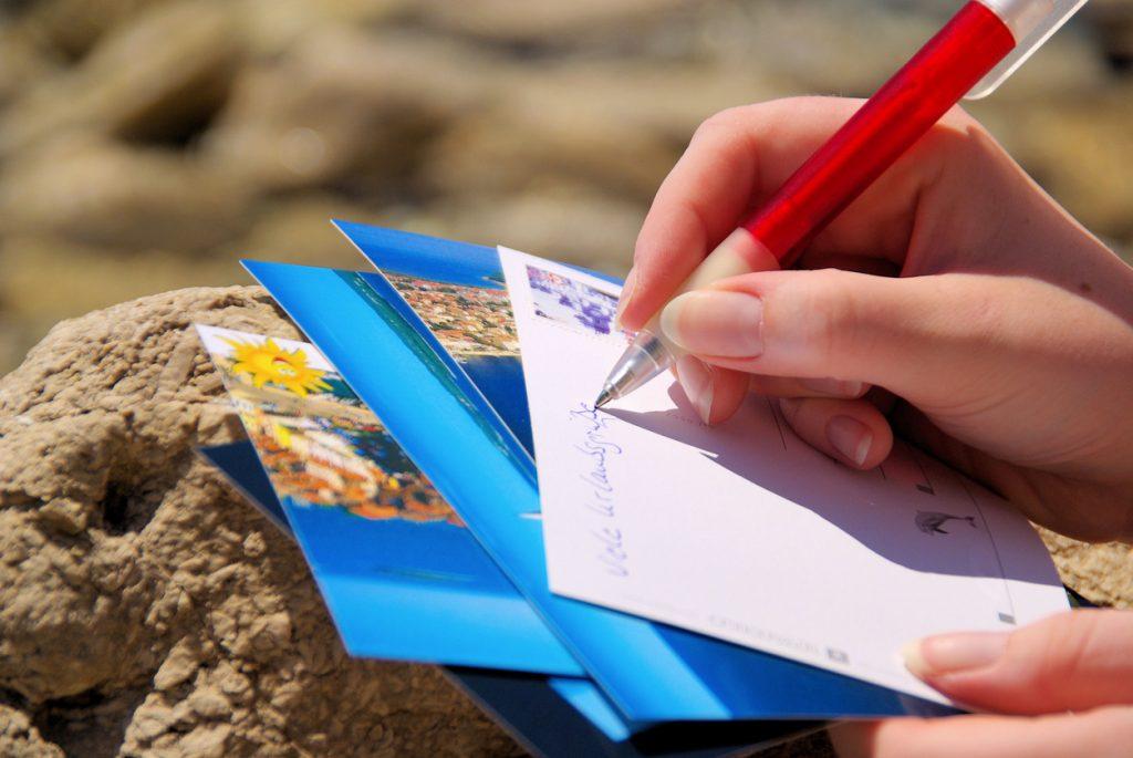 Hand writing various postcards