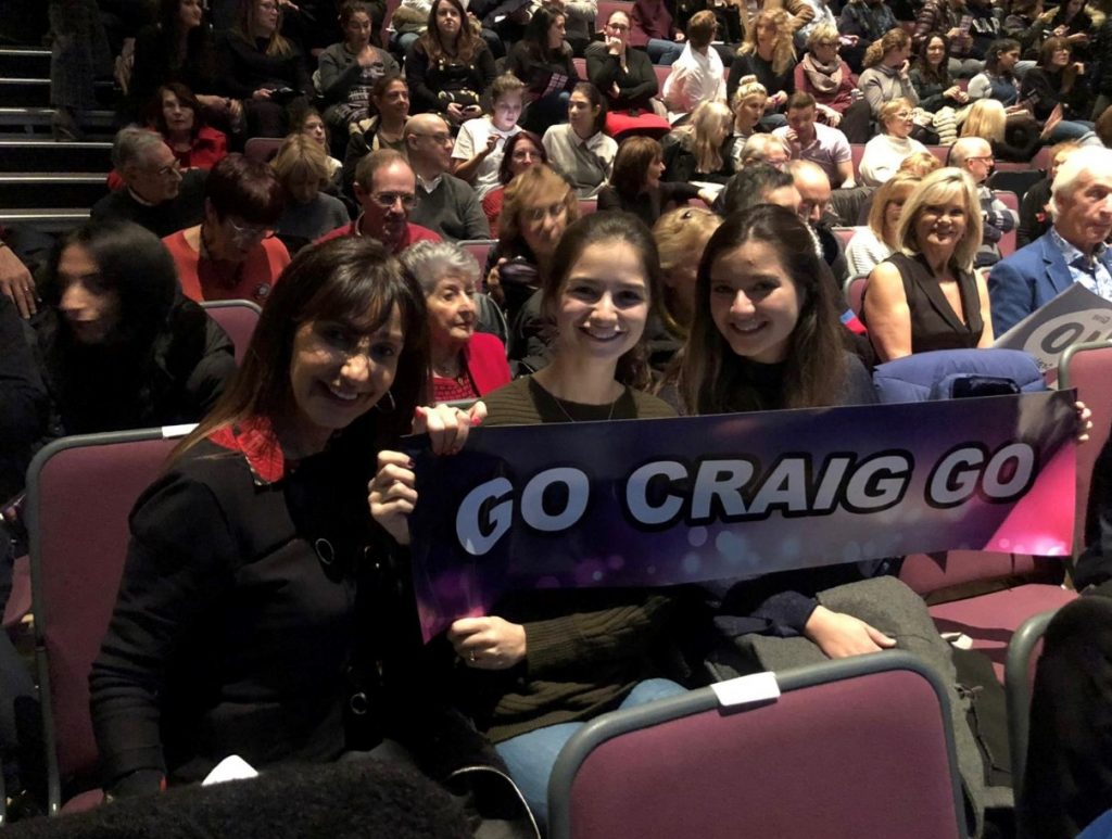 Craig Feldman's family hold a sign saying 'Go Craig Go' at Dancing Strictly