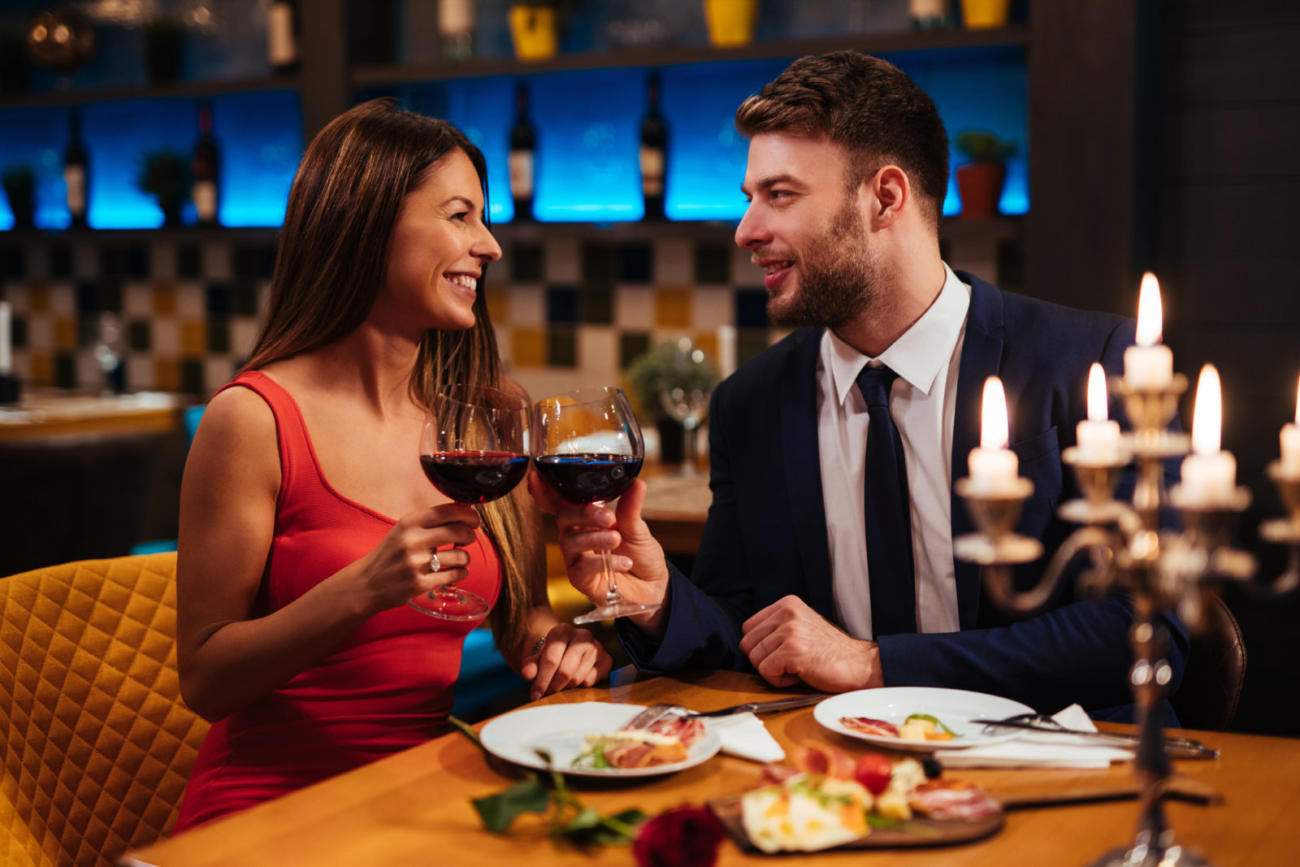 Couple enjoying red wine on Valentine's Day in Manchester